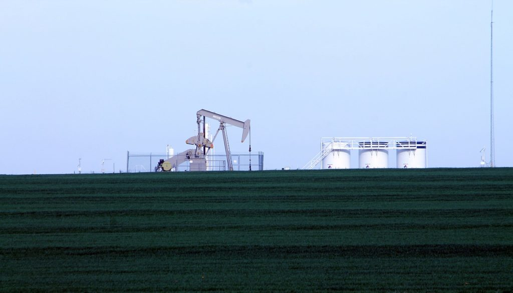Clark Weeks suggest you invest in oil - picture of an oil well